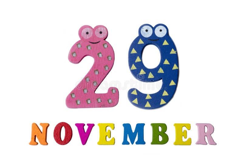 29 de novembro no fundo, nos números e nas letras brancos fotografia de stock royalty free