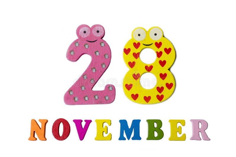 28 de novembro no fundo, nos números e nas letras brancos foto de stock royalty free