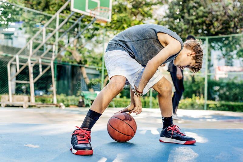 De Oefeningsconcept van Sport Skill Playing van de basketbalatleet royalty-vrije stock foto's