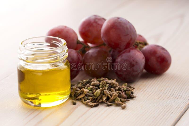 De Olie van het Zaad van de druif stock afbeeldingen