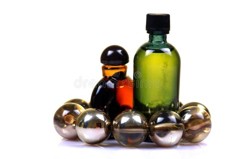 De olieflessen van de massage stock fotografie