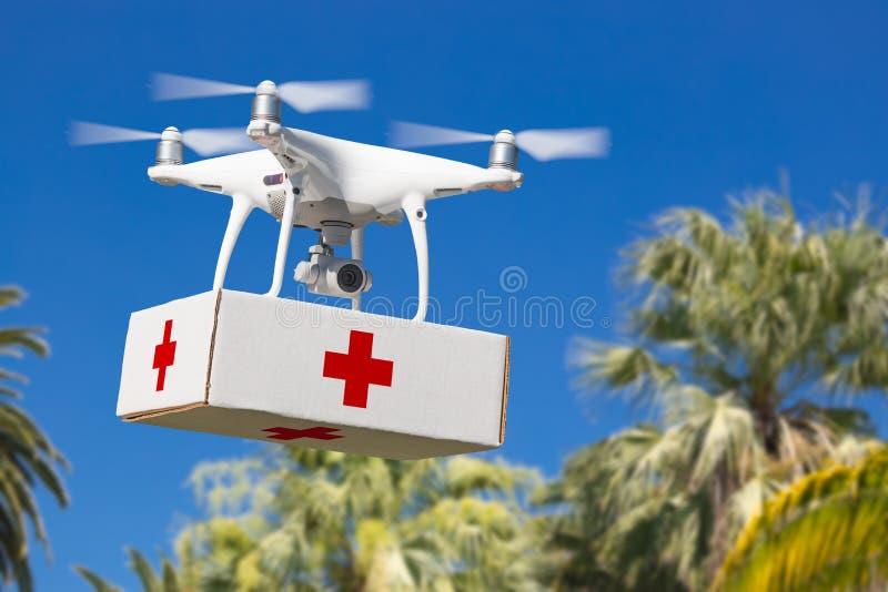 De onbemande Uitrusting van de de Hommel Dragende Eerste Assistent van het Vliegtuigensysteem UAS Quadcopter royalty-vrije stock afbeeldingen