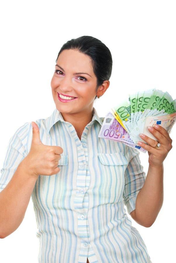 De onderneemster met geld het geven beduimelt omhoog royalty-vrije stock foto
