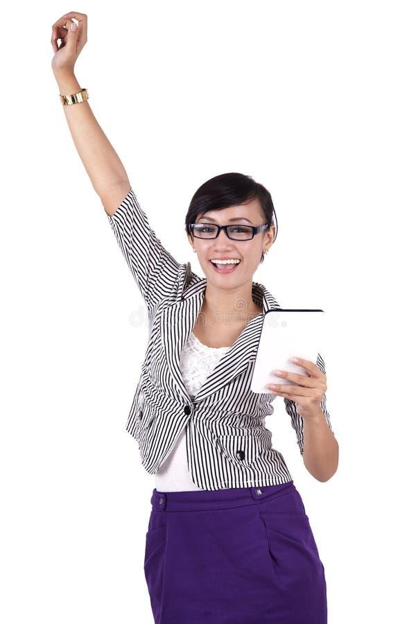 De onderneemster van het succes met iPadtablet stock afbeelding