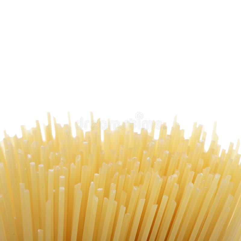 De ongekookte macaroni van de deegwarenspaghetti royalty-vrije stock afbeeldingen