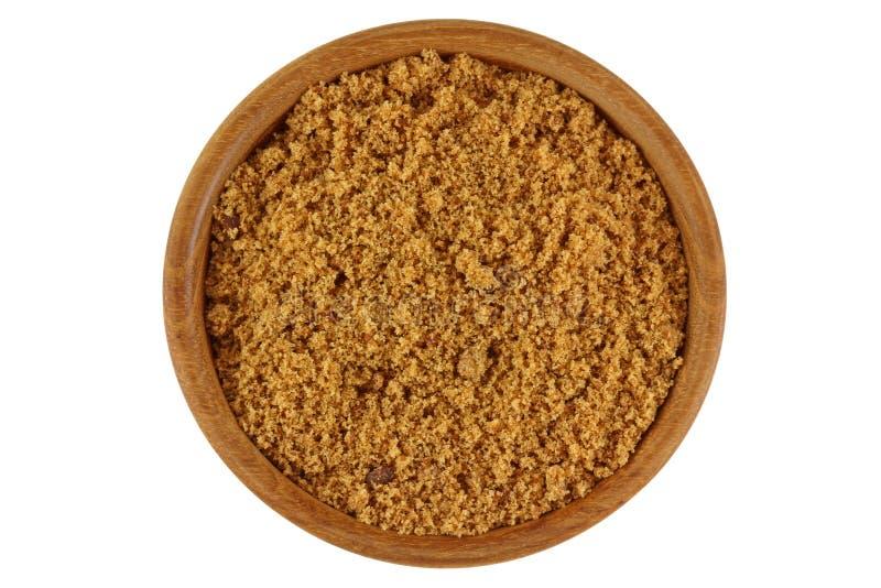De ongeraffineerde niet gebleekte natuurlijke Bruine suiker in bruine kleur in streeft na stock fotografie