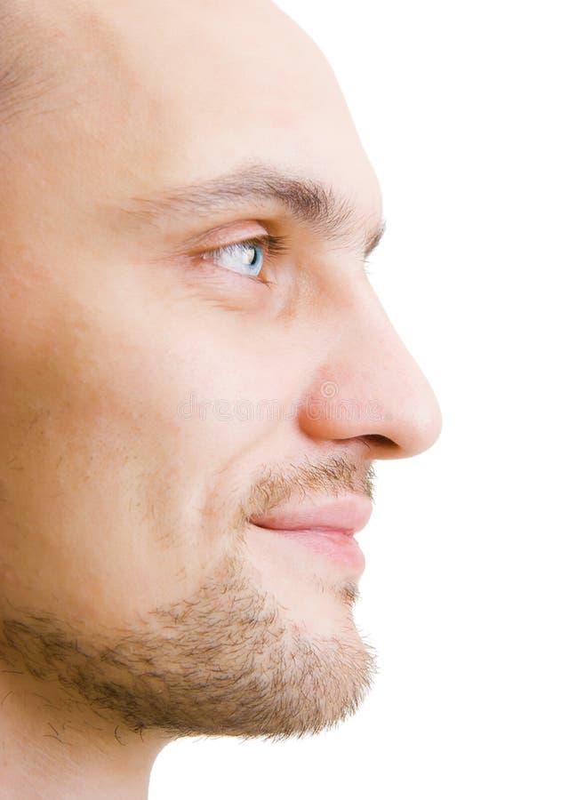 De ongeschoren jonge mens van het gezicht in profiel stock foto's