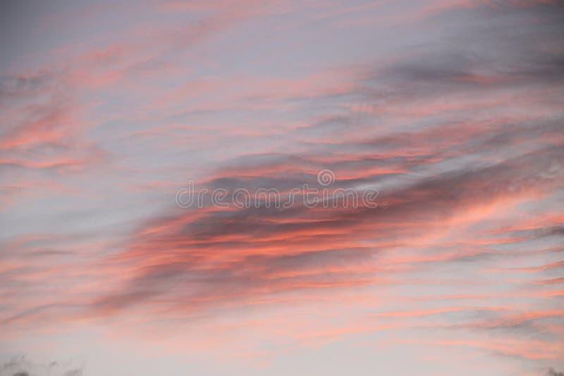 De onscherpe achtergrond van de zonsondergangwolk stock foto's
