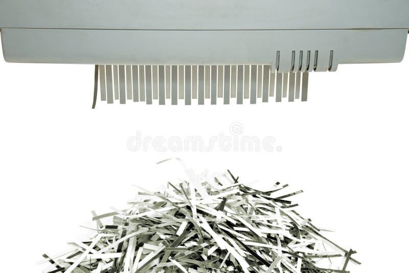 De ontvezelmachine van het document en het stukje zetten op stock foto's