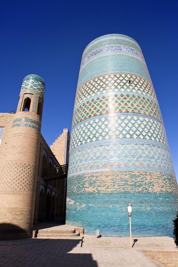 De onvolledige Minder belangrijke Minaret van Kalta (minaret Muhammad Amin Khan (19de eeuw)) Khiva, Oezbekistan stock foto's