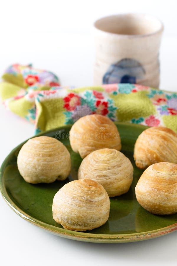 De oosterse gebakjemaan van Huaiyang van het voedselconcept eigengemaakte organische Spiraalvormige Chinese cake van de het vlokk royalty-vrije stock foto's