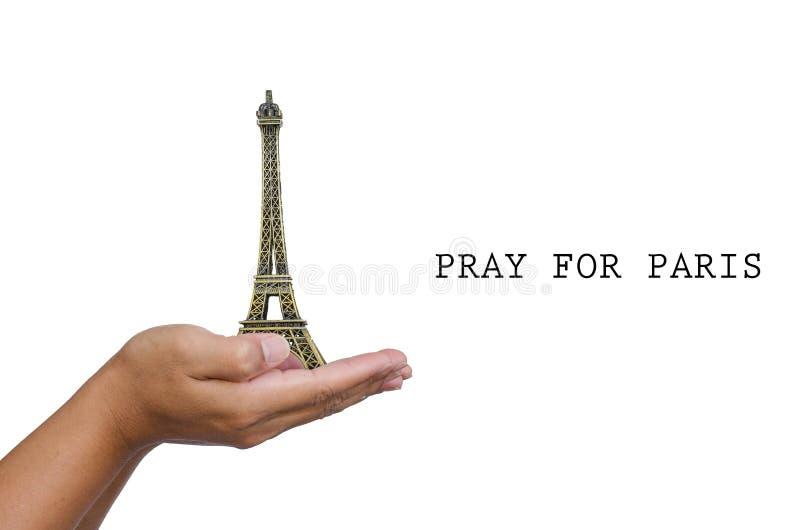 De open hand met een model de Toren van Eiffel en heeft woord voor Parijs bidden royalty-vrije stock afbeeldingen