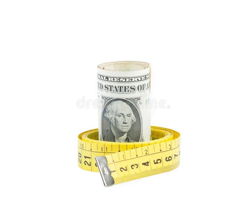 De opgerolde dollars binnen maatregel binden op witte achtergrond, concept voor zaken vast en besparen geld royalty-vrije stock afbeeldingen