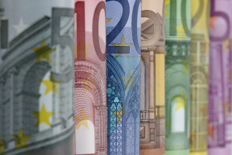 De opgerolde Euro rekeningen, sluiten omhoog stock afbeeldingen