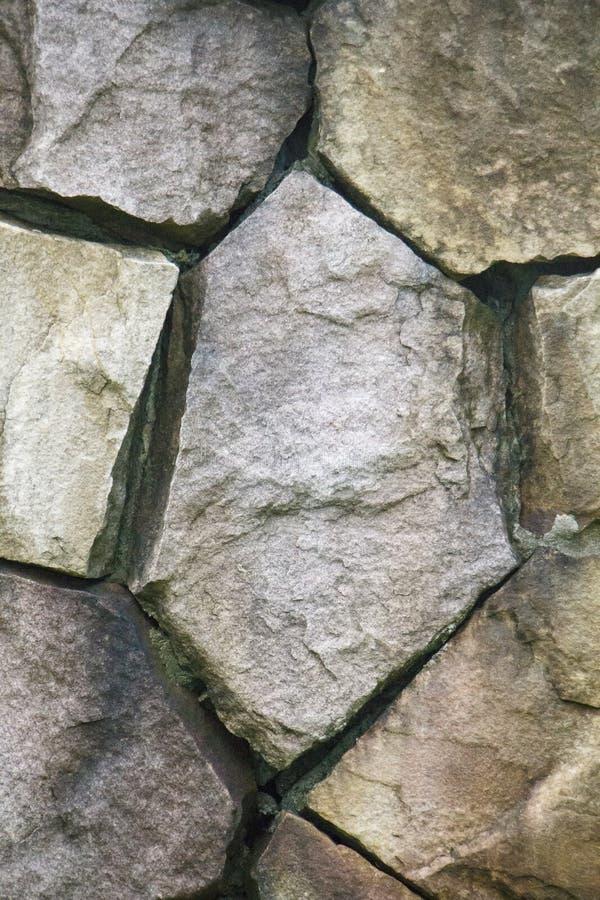 De oppervlakte van de steenmuur kan als achtergrondpatroon of textuur gebruiken stock afbeelding