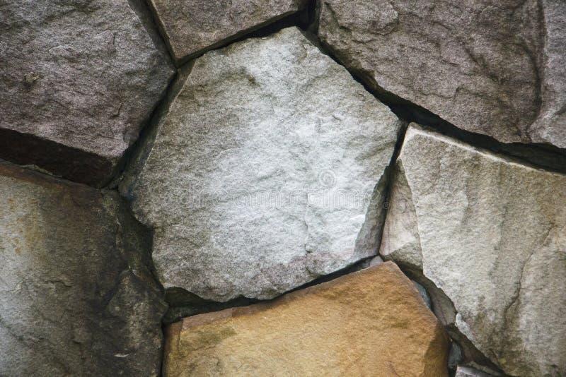 De oppervlakte van de steenmuur kan als achtergrondpatroon of textuur gebruiken stock afbeeldingen