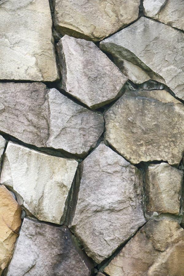De oppervlakte van de steenmuur kan als achtergrondpatroon of textuur gebruiken stock fotografie