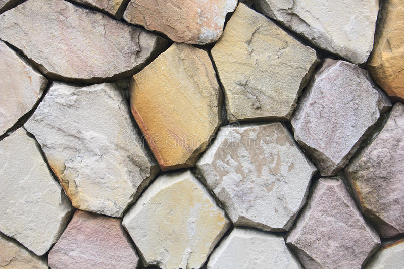 De oppervlakte van de steenmuur kan als achtergrondpatroon of textuur gebruiken royalty-vrije stock afbeeldingen