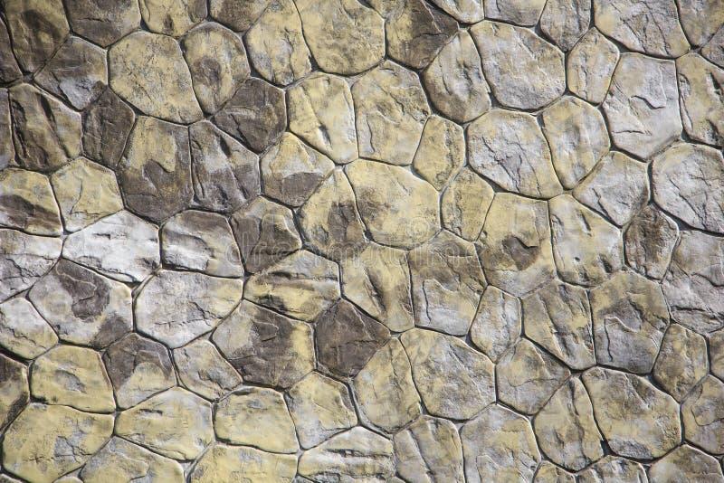 De oppervlakte van de steenmuur kan als achtergrondpatroon of textuur gebruiken royalty-vrije stock afbeelding