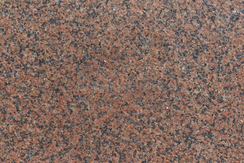 De oppervlakte van de granietplak is bruin met vlekken royalty-vrije illustratie