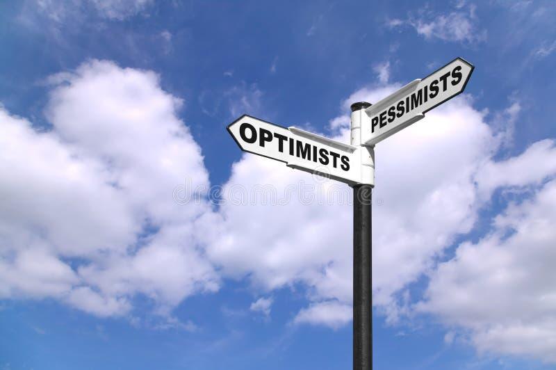 De optimisten en de Pessimisten voorzien van wegwijzers stock fotografie