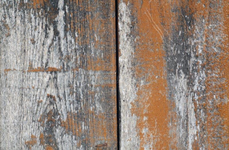 De oranje achtergrond van kleuren oude grungy houten planken stock afbeelding