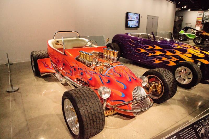 De oranje Ster van Ford Altered T van 1925 geroepen Gouden Open tweepersoonsauto royalty-vrije stock afbeeldingen