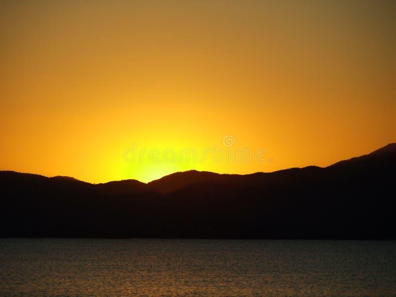 De Oranje Zon van de zonsondergang stock fotografie