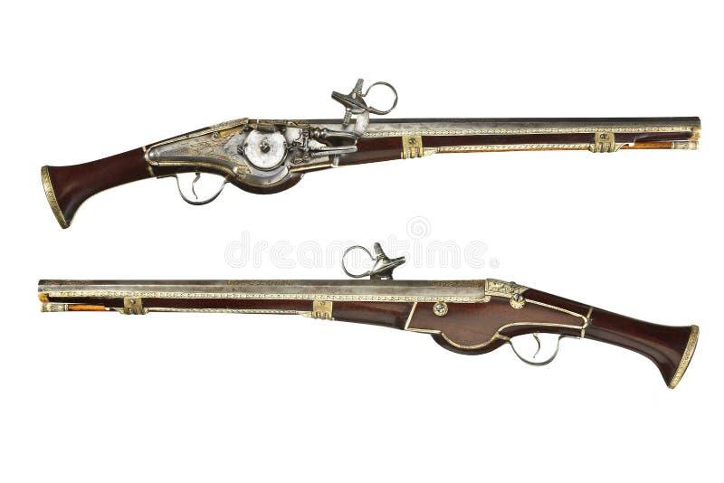 De originele antiquiteit van het pistolenpaar wheelock en vuursteenpistolen royalty-vrije stock foto's