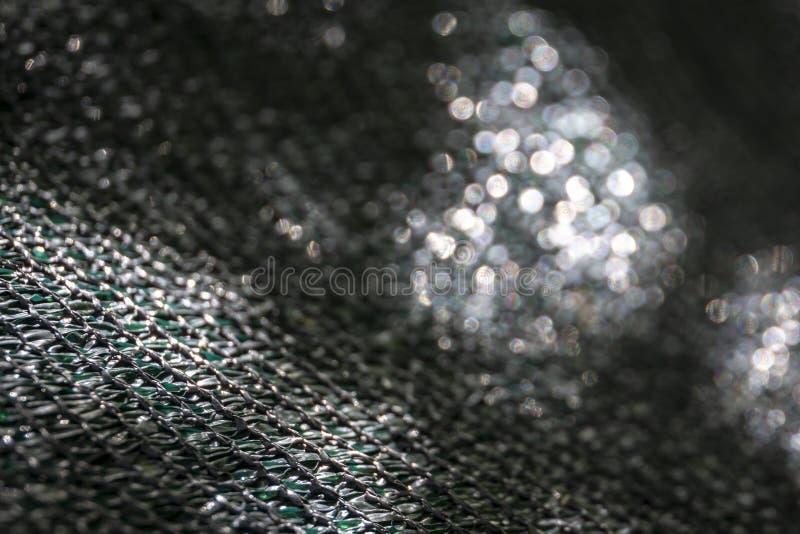 De originele textuur van het geweven netwerk of zwarte nylon netto stock foto