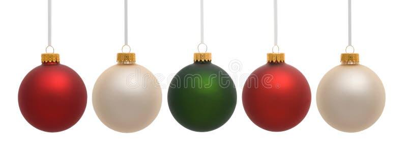 De Ornamenten die van Kerstmis op Wit hangen royalty-vrije stock afbeeldingen