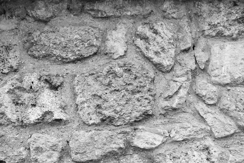 De oude achtergrond van de grungesteen Zwart-witte kleurenfotografie royalty-vrije stock foto's