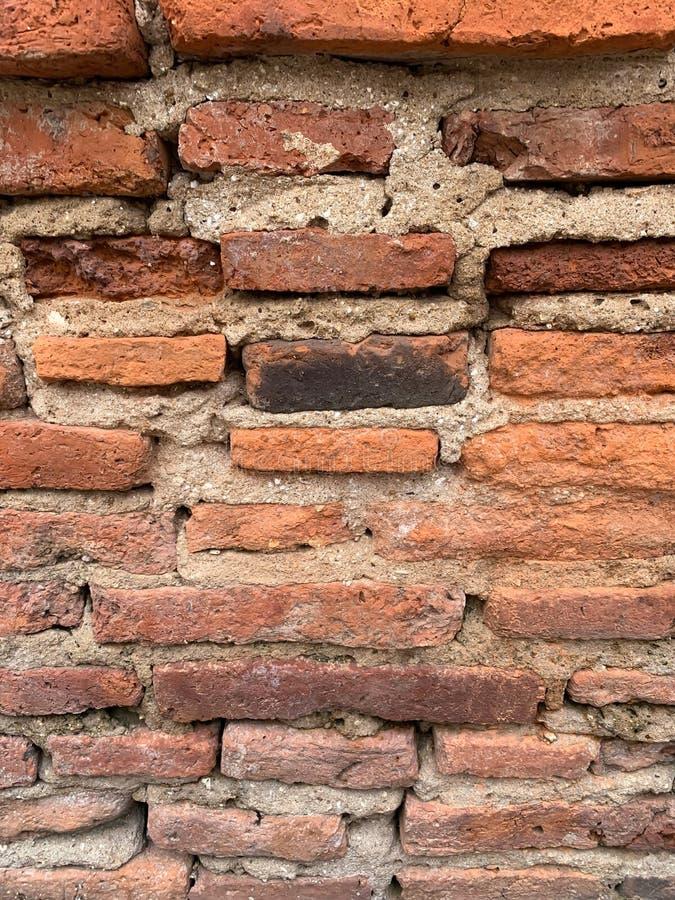 De oude bakstenen muurachtergrond royalty-vrije stock afbeeldingen