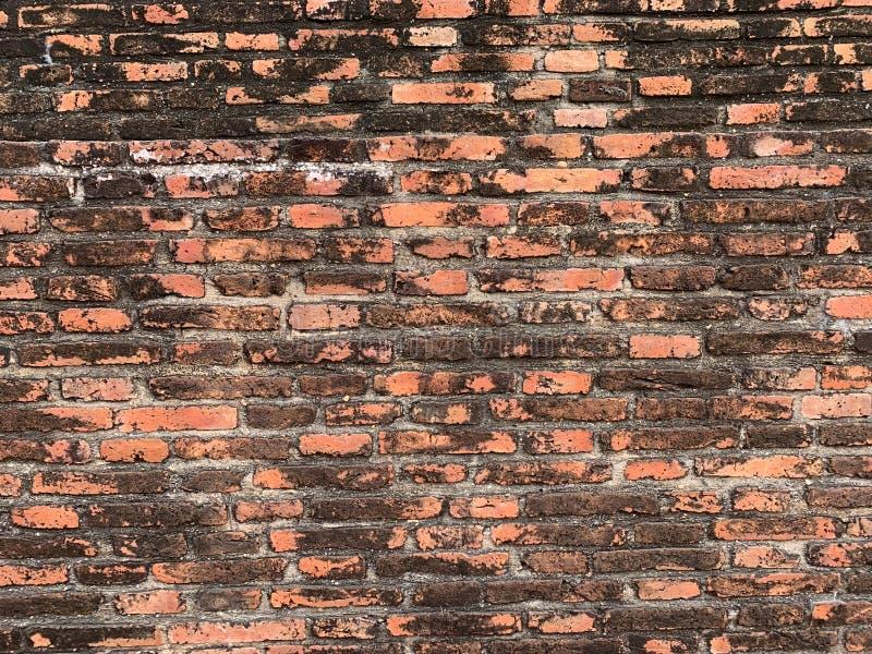 De oude bakstenen muurachtergrond stock foto