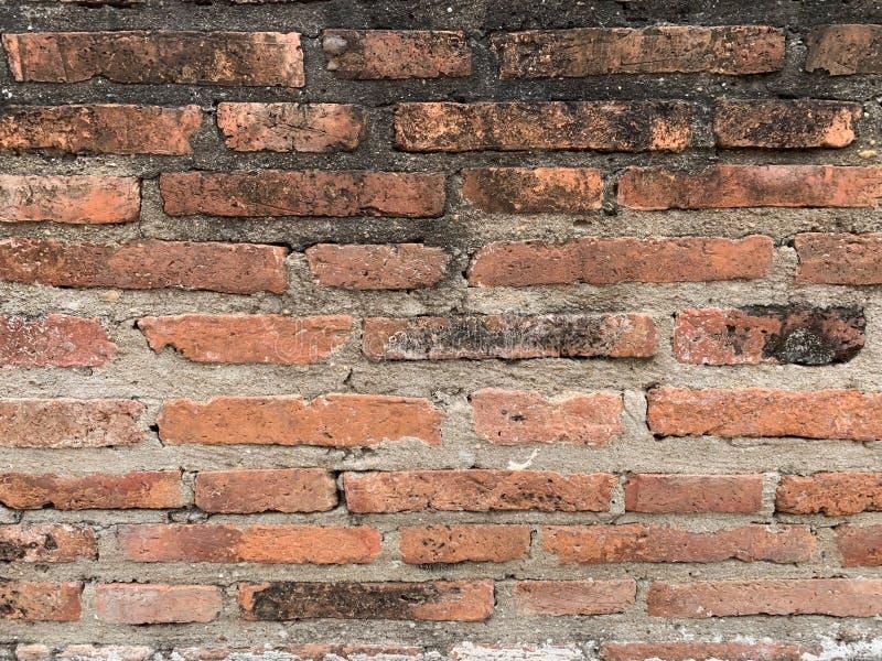 De oude bakstenen muurachtergrond royalty-vrije stock afbeelding