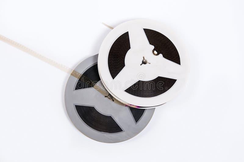 De oude die strook van de cinematografiefilm op witte achtergrond wordt geïsoleerd stock afbeelding