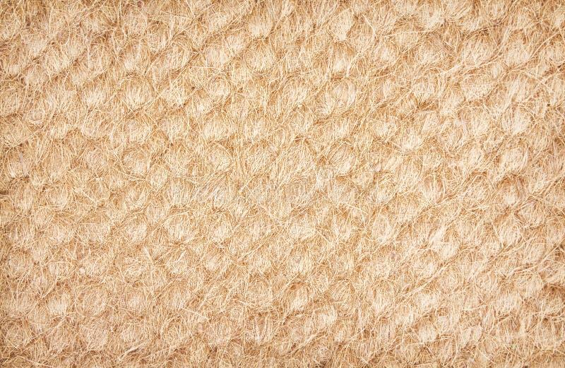 De oude droge textuur van de kokosvezeldeurmat, de achtergrond van aardpatronen stock foto's
