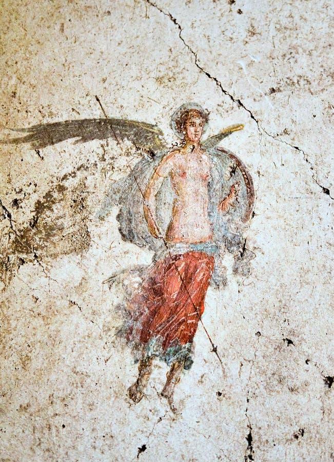 De oude fresko van Pompei van een gevleugelde militair met spear en schild stock afbeeldingen