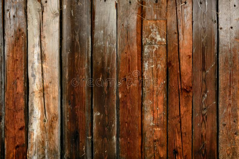 De oude grijze muur van de raad, de donkere textuur stock fotografie