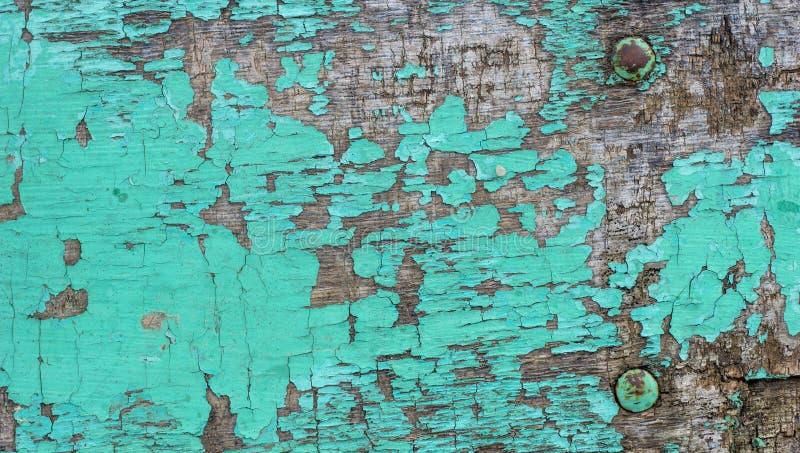 De oude grunge rustieke houten geweven achtergrond met groene kleur barstte doorstane verf en krassen stock afbeelding