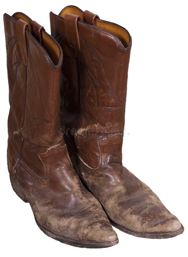 De oude Laarzen van de Cowboy, Westelijke Slijtage, die op Wit wordt geïsoleerdn stock afbeelding