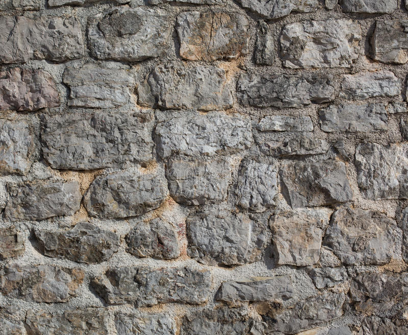 De oude muur van de kasteelsteen stock afbeelding