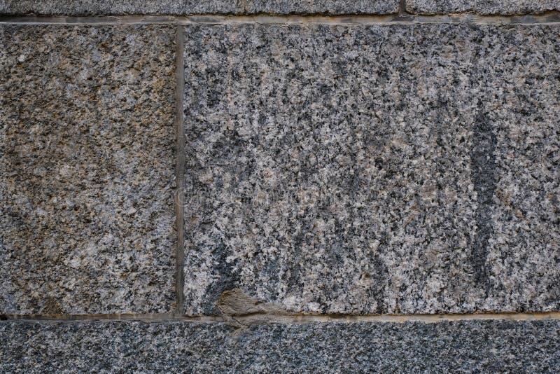 De oude muur van de granietsteen Oude muur metselwerktextuur, de achtergrond van het metselwerkpatroon stock afbeelding