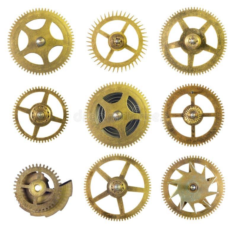 De oude Radertjes van de Klok stock afbeeldingen