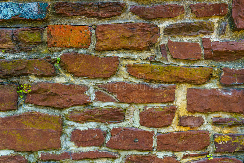 De oude rode baksteen en steentextuur van het muurcement stock fotografie