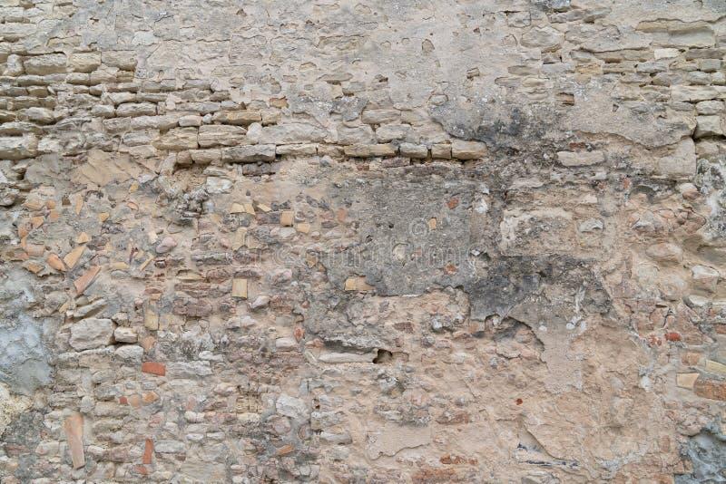 De oude steen Beschadigde achtergrond van de Muurtextuur royalty-vrije stock afbeeldingen