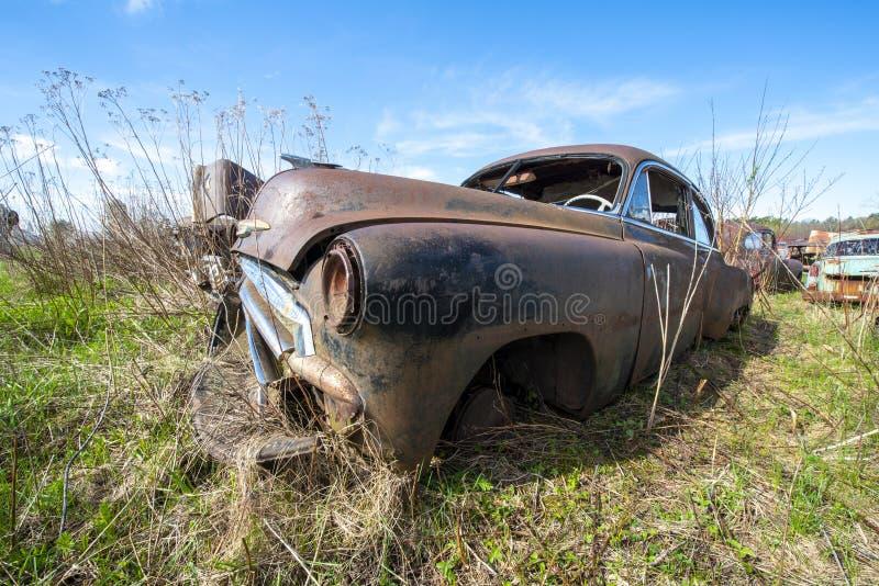 De oude Uitstekende Auto van de Troepwerf, Roest royalty-vrije stock foto
