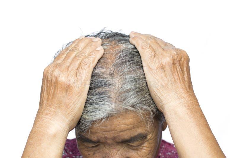 De oude vrouw voelde heel wat bezorgdheid over de kwestie van het haarverlies stock afbeeldingen