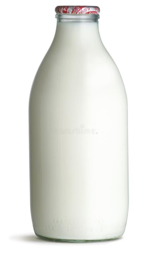De ouderwetse fles van het pintglas melk op een wit stock afbeeldingen