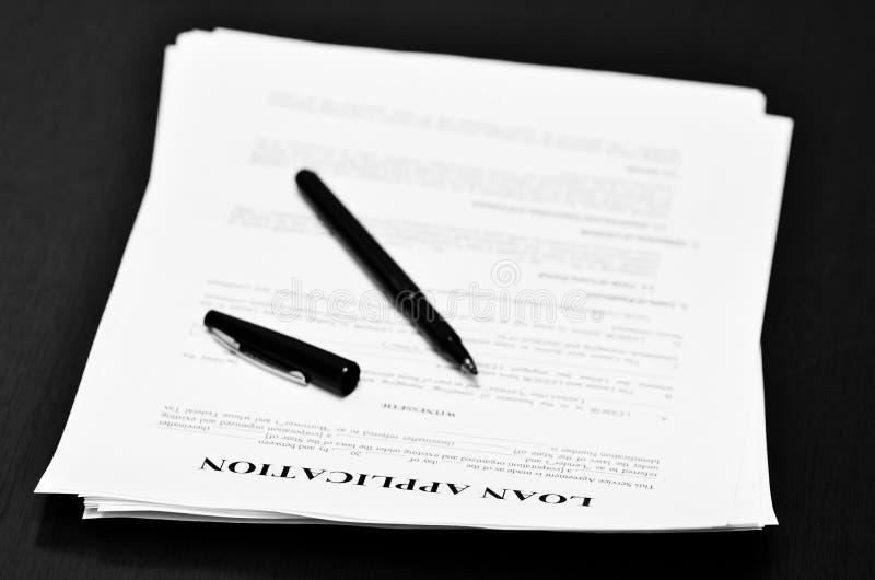 De Overeenkomst van het leningsdocument over Bureau met Pen stock afbeeldingen